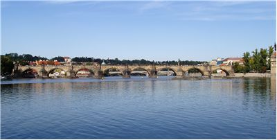Charles Bridge Crosses The Vltava River